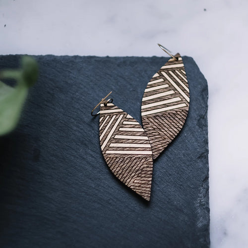 wood leaf earrings with golden etched lines, gilded wood earrings, Austin jewelry, artisan wood wearable art, social impact jewelry, ethical accessory