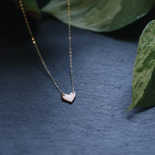 tiny gold-rimmed heart necklace