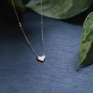 tiny gold-rimmed heart necklace, sweetheart necklace, gold filigree jewelry, white and gold, Austin jewelry, porcelain wearable art, social impact jewelry, ethical accessory