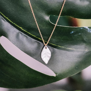 water-etched leaf necklace, white and gold leaf, Austin jewelry, social impact jewelry, ethical accessory