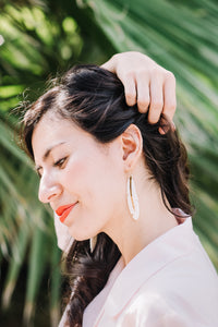 large feather white porcelain earrings with gold accent, gold filigree jewelry, white and gold, Austin jewelry, porcelain wearable art, social impact jewelry, ethical accessory