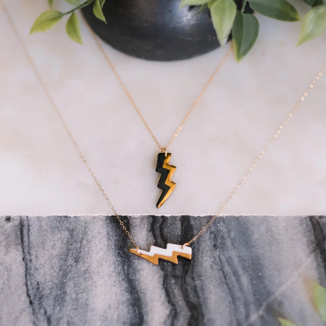 lightning bolt necklace with gold accent, gold filigree jewelry, white and gold, black and gold, Austin jewelry, porcelain wearable art, social impact jewelry, ethical accessory