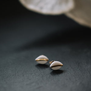 tiny leaf studs with gold accent, gold filigree jewelry, white and gold, Austin jewelry, porcelain wearable art, social impact jewelry, ethical accessory