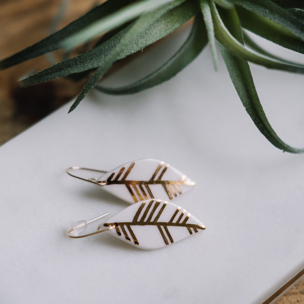 hanging leaf earrings with gold accent, white and gold earrings, Austin jewelry, social impact jewelry, ethical accessory