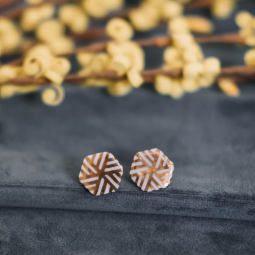geometric earrings, gold filigree jewelry, white and gold, gold studs, Austin jewelry, porcelain wearable art, social impact jewelry, ethical accessory