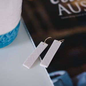 white textured gold rectangle earrings, Austin jewelry, porcelain wearable art, social impact jewelry, ethical accessory