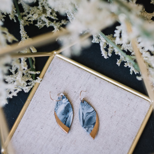 granite black and blue marbled leaf earrings, gold filigree jewelry, Austin jewelry, porcelain wearable art, social impact jewelry, ethical accessory