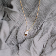 tiny gold accented leaf necklace