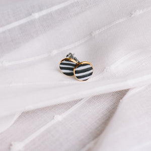 circle stripe earrings, gold filigree jewelry, black and white stripes, gold studs, Austin jewelry, porcelain wearable art, social impact jewelry, ethical accessory