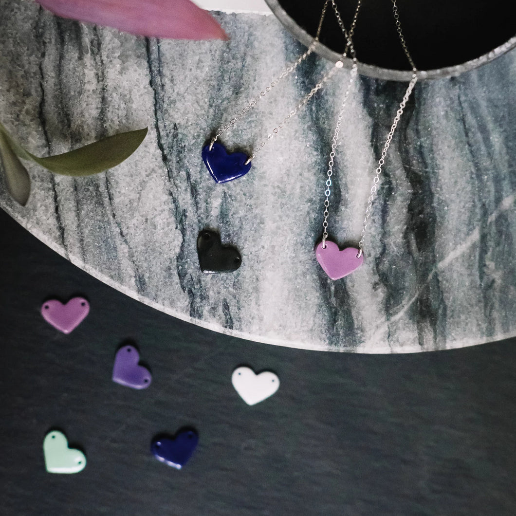 porcelain heart necklace, micro heart, Austin jewelry, social impact jewelry, ethical accessory, everyday love jewelry, blue heart, pink heart, black heart, white heart