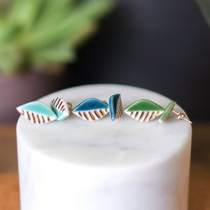 green and gold leaf studs