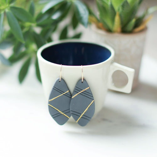 grey and gold earrings, porcelain jewelry, grey and gold jewelry, austin jeweler, austin brand, ethical jewelry, porcelain earrings, clay earrings