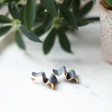grey ribbon studs