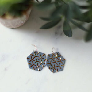 grey hexagon earrings, porcelain jewelry, porcelain earrings, clay jewelry, grey jewelry, gray jewelry, remnant studios, non-profit jewelry, ethical jewelry, gold and grey, gold and grey jewelry
