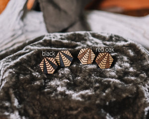 wood hexagon studs with gold accent, geometric gilded earrings, Austin jewelry, artisan wood wearable art, social impact jewelry, ethical accessory