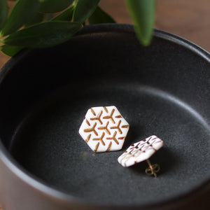 white and gold hexagon studs