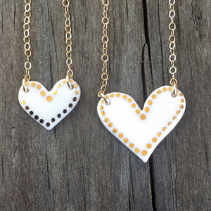 Dot bordered porcelain heart necklace, gold filigree jewelry, white and gold, Austin jewelry, porcelain wearable art, social impact jewelry, ethical accessory