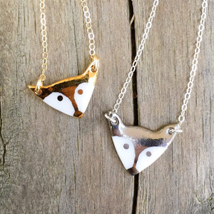 porcelain fox necklace with gold accent, gold filigree jewelry, white and gold, Austin jewelry, porcelain wearable art, social impact jewelry, ethical accessory