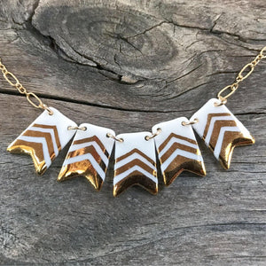 porcelain and gold pennant banner necklace, beaded gold necklace, Austin jewelry, social impact jewelry, ethical accessory, white and gold