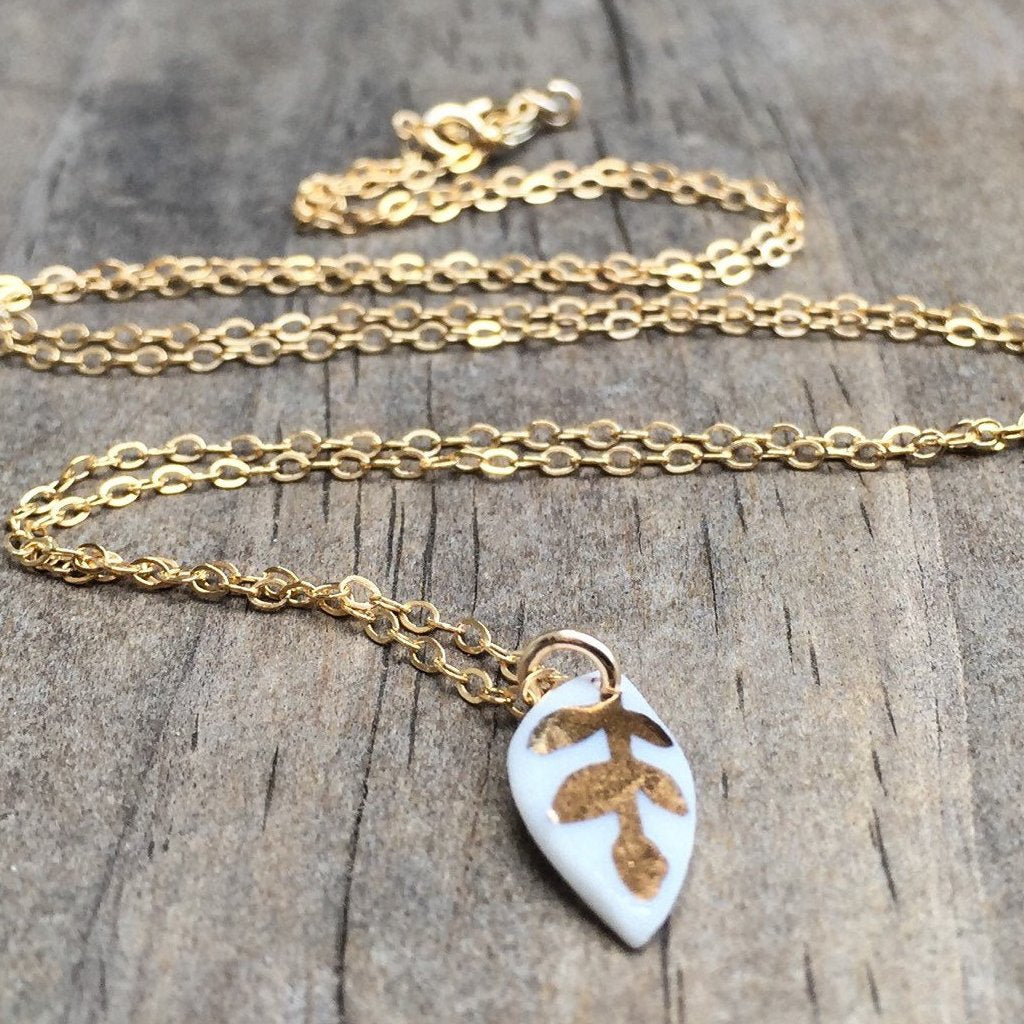 tiny white porcelain leaf  - gold glazed - necklace