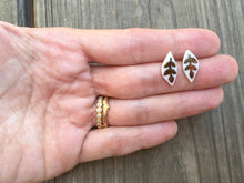 small white porcelain leaf studs with gold or white-gold design, Austin jewelry, social impact jewelry, ethical accessory