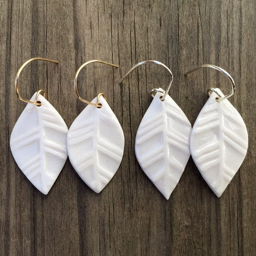 medium porcelain water etched leaf earrings, Austin jewelry, porcelain wearable art, social impact jewelry, ethical accessory