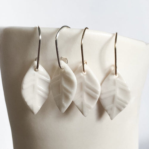 small white porcelain leaf earrings with water etched design, Austin jewelry, social impact jewelry, ethical accessory