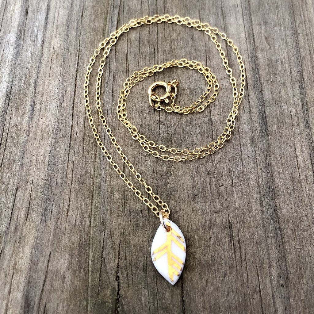 white porcelain leaf necklace with gold accent