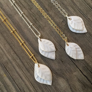 small stacked water etched porcelain white leaves necklace, geometric earrings, Austin jewelry, porcelain wearable art, social impact jewelry, ethical accessory