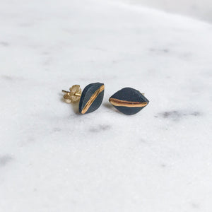 tiny leaf studs with gold accent, gold filigree jewelry, white and gold, charcoal and gold, Austin jewelry, porcelain wearable art, social impact jewelry, ethical accessory