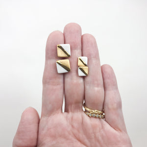 diagonal gold studs