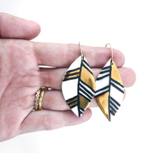 large leaf earrings with black and gold accent