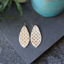 oval with crosses earrings