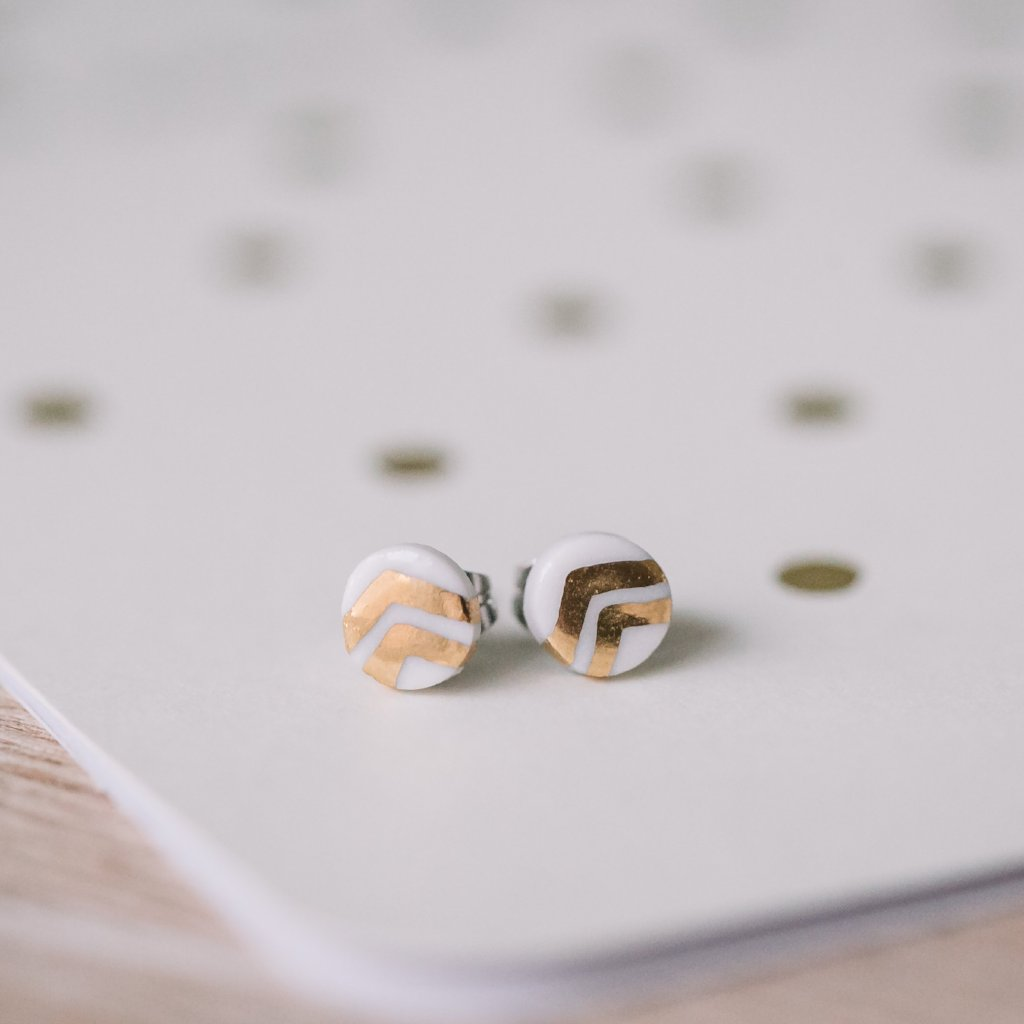 tiny dot studs with gold chevron accent, gold filigree jewelry, white and gold, Austin jewelry, porcelain wearable art, social impact jewelry, ethical accessory