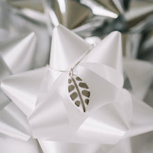 leaf necklace with silver accent, white and platinum leaf, Austin jewelry, social impact jewelry, ethical accessory