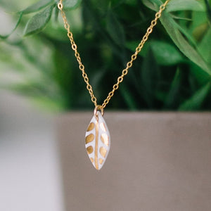 leaf necklace with gold accent, white and gold leaf, Austin jewelry, social impact jewelry, ethical accessory