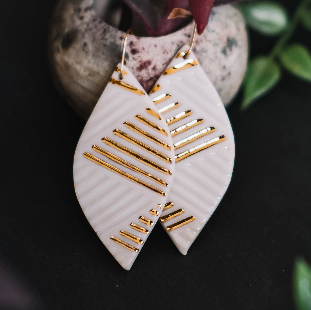 etched leaf earrings with gold accent, gold filigree jewelry, white and gold, Austin jewelry, porcelain wearable art, social impact jewelry, ethical accessory