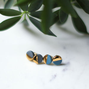 grey or teal round metallic studs