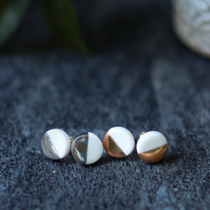 white and gold accented studs