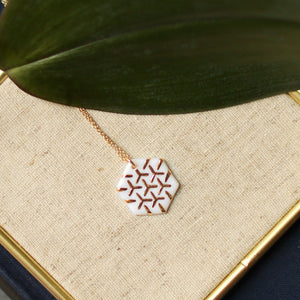white and gold hexagon necklace
