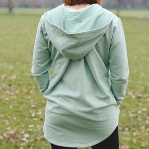 Harlyn hoody in sage showing unique back pleat