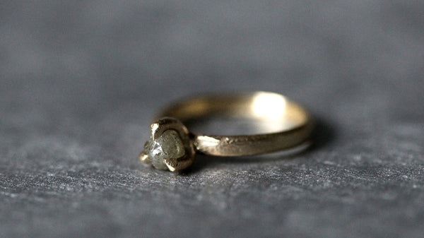 Claw set rough diamond ring in yellow gold by Tamara Gomez