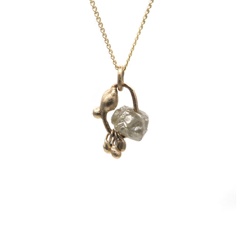 Rough diamond charm necklace in yellow gold