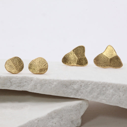 Forged gold stud earrings by Tamara Gomez