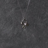 Rough diamond charm necklace in white gold