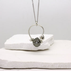 Rough diamond charm necklace in white gold by Tamara Gomez