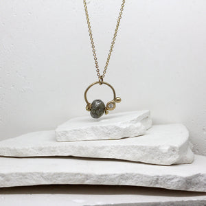 Rough diamond charm necklace in yellow gold by Tamara Gomez