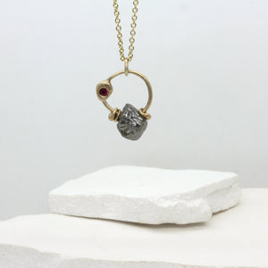 Rough diamond charm necklace in yellow gold with ruby by Tamara Gomez