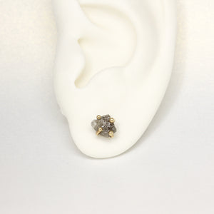 Claw set rough diamond stud earrings in yellow gold