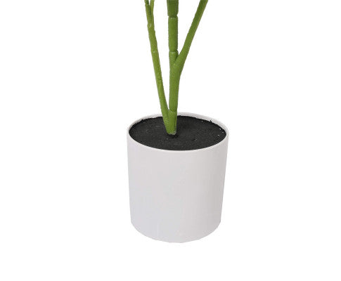 Artificial grape vine in a white pot